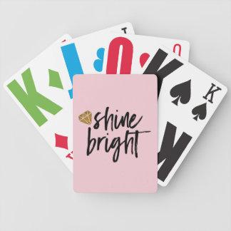 Ljus text för grafiskt sken med den guld- spelkort