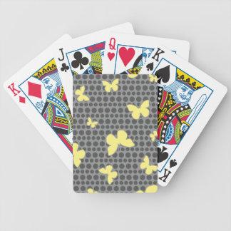 Ljusa gula fjärilar på grå färg spelkort