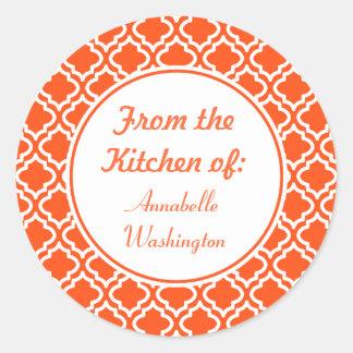Ljusa orange kökklistermärkear runt klistermärke