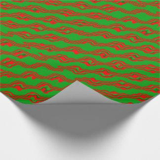 Ljust - gröna Squiggles på den röda Presentpapper
