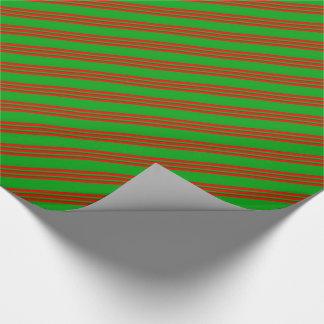 Ljust - grönt görar randig på den röda presentpapper