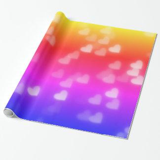 Ljust regnbågehjärtaBokeh mönster Presentpapper