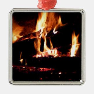 Loggar in den varma spisen avfyrar fotografi silverfärgad fyrkantigt julgransprydnad