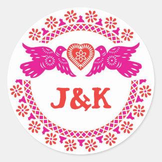 Lovebirdsrosor och röd rundaklistermärke runt klistermärke