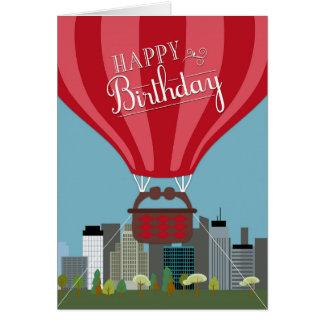 Luftballong framme av horisontfödelsedagkortet hälsningskort