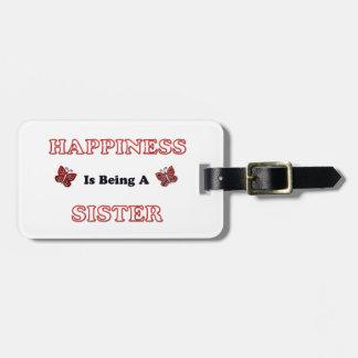 Lyckan är en syster bagagebricka