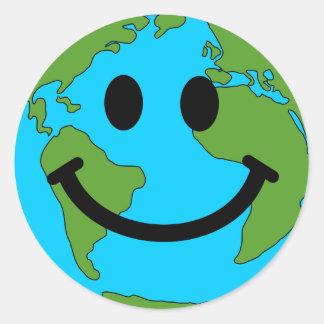 Lycklig jordsmiley face runt klistermärke