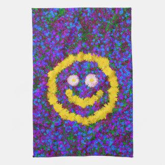 Lyckliga smiley facemaskrosblommor kökshandduk