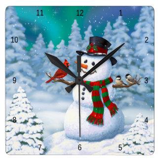 Lyckliga snögubbe- och vinterfåglar fyrkantig klocka