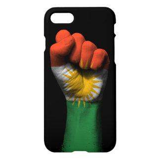 Lyftt gripen hård om näve med Kurdish flagga