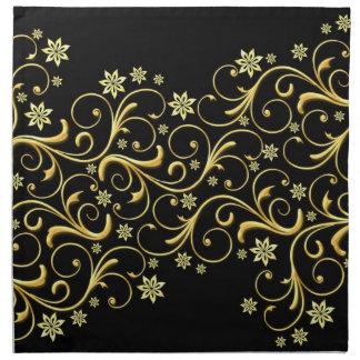 Lyxigt guld virvlar runt snörebröllopservetter tygservett