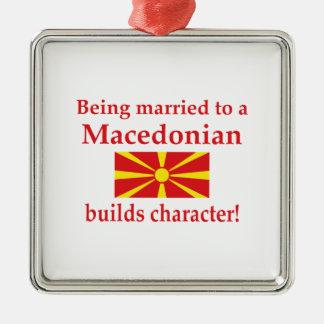 Macedonianen bygger teckenet julgransprydnad metall