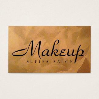 Makeupkonstnären förkopprar den metalliska visitkort