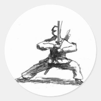 Man med svärd runt klistermärke