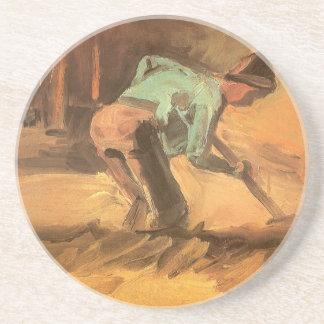 Man som luta sig ner med pinnen eller spaden, underlägg sandsten