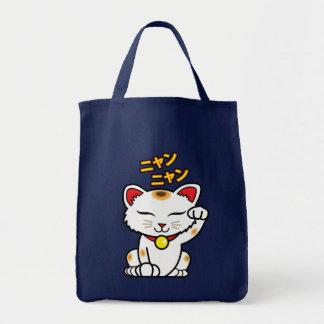 Maneki Neko hänger lös den japanska lyckliga kattt Tygkasse