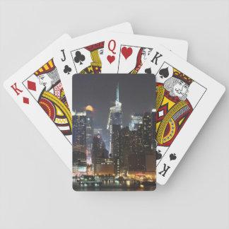 Månelöneförhöjningar över midtownen New York. Spel Kort