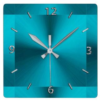 Metallisk turkosblåttgrönt tar tid på fyrkantig klocka