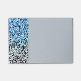 Metalliska fluorescerande blommor för blått post-it block