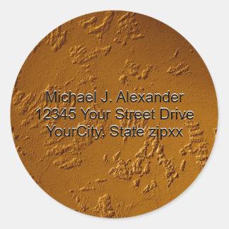 Metalliskt brons runt klistermärke