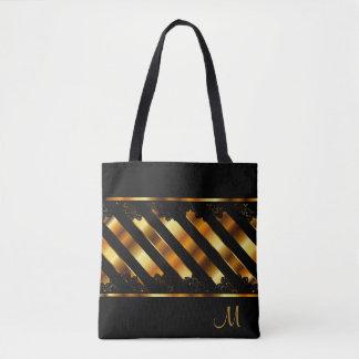 Metalliskt guld och svart snöredesign tygkasse