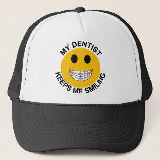 Min tandläkare håller mig att le truckerkeps