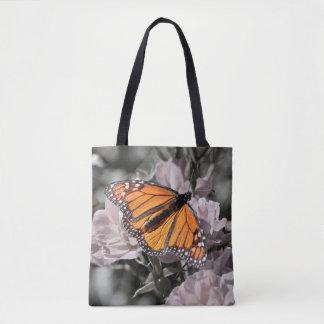 Monarkfjäril på dämpade rosa- och grå färgblommor tygkasse