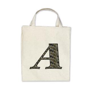Monogramen märka med sina initialer en vanlig hort tote bags