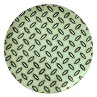 Mönstrad grönt pläterar tallrik