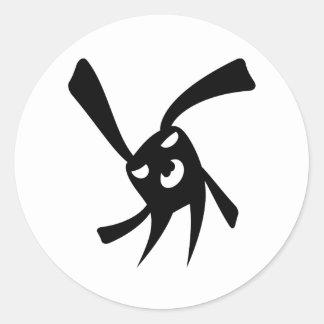 Mörk kanin runt klistermärke