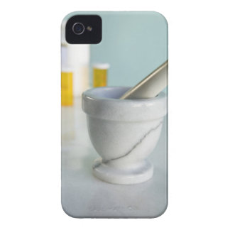 Mortel och Pestle, Pillflaskor i bakgrund iPhone 4 Hud