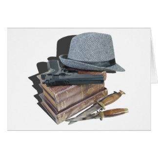 MurderMysteryBooksGunKnivesFedora042113.png Hälsningskort