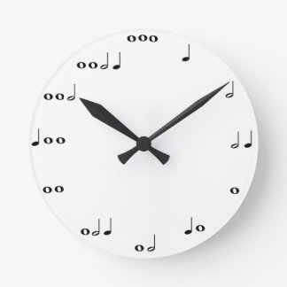 Musik noter tar tid på rund klocka