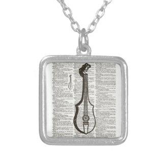 Musikalen instrumenterar ordbokkonst silverpläterat halsband