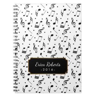 Musikmönster med känd elegant musikal anteckningsbok med spiral