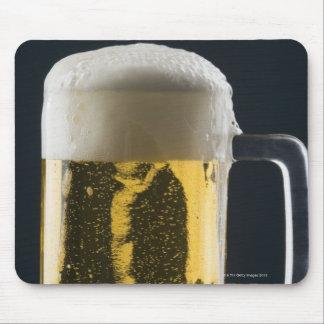 Närbild av ett exponeringsglas av öl musmatta