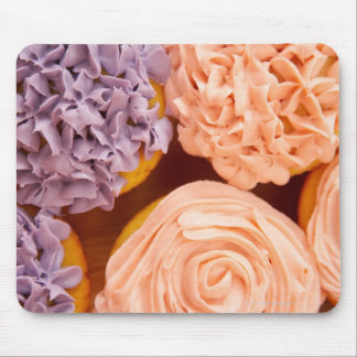 Närbild av frostad muffins musmatta