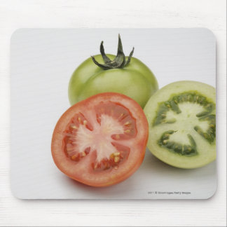Närbild av tre tomater musmatta