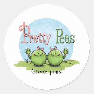 Nätt ärtor - veggies kopplar samman flickor runt klistermärke