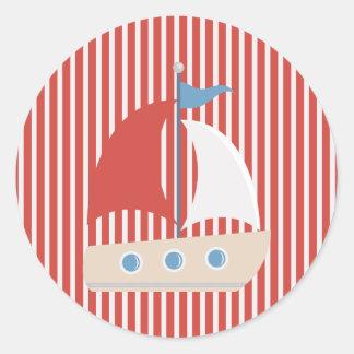 Nautiska röda vitrandar och fartygklistermärke runt klistermärke