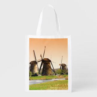 Nederländerna Kinderdijk. Windmills bredvid Återanvändbar Påse
