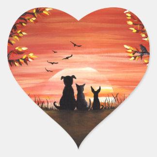 Nedgång för för höstsolnedgånghund och katt hjärtformat klistermärke
