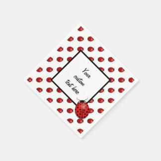 Nyckelpigor i rött papper servetter