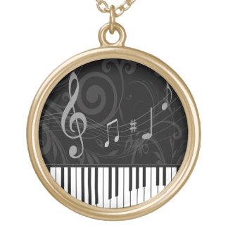 Nyckfullt piano och musik noter halsband med rund hängsmycke