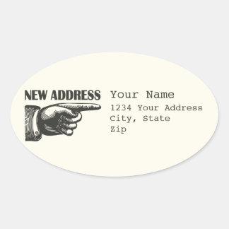 Nytt adress peka räcker ovalt klistermärke