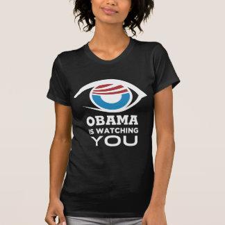 Obama HÅLLER ÖGONEN PÅ DIG den Obama ögaPRISMAN Tee Shirt