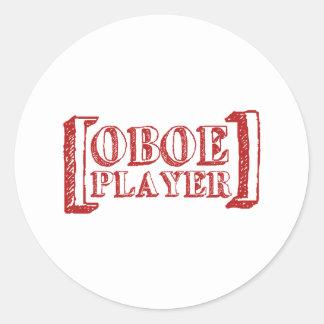 Oboe spelare runt klistermärke