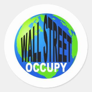 Occupy wall street globalt runt klistermärke