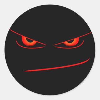 onda röda ögon förseglar runt klistermärke