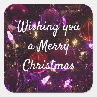 Önska dig god jul lilaklistermärkear fyrkantigt klistermärke